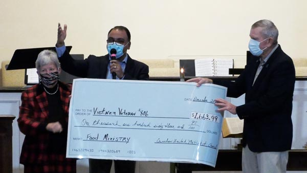 CUMC presents Vietnam Veterans #806 with a check for $1663.99 for their food ministry.
